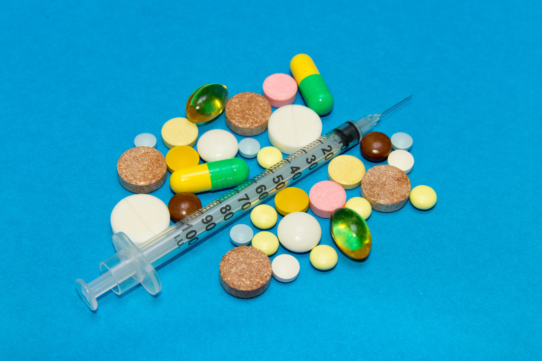 Pills and syringe