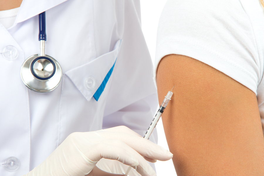 Doctor Making Insulin Or Flu Vaccination