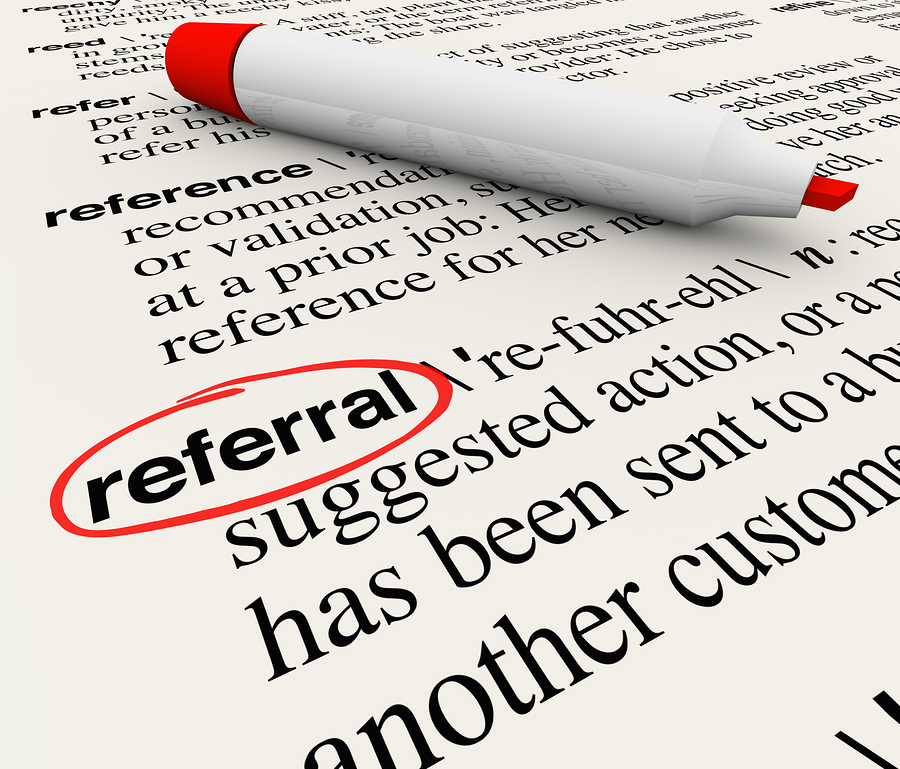The word Referral circled in a dictionary showing its definition