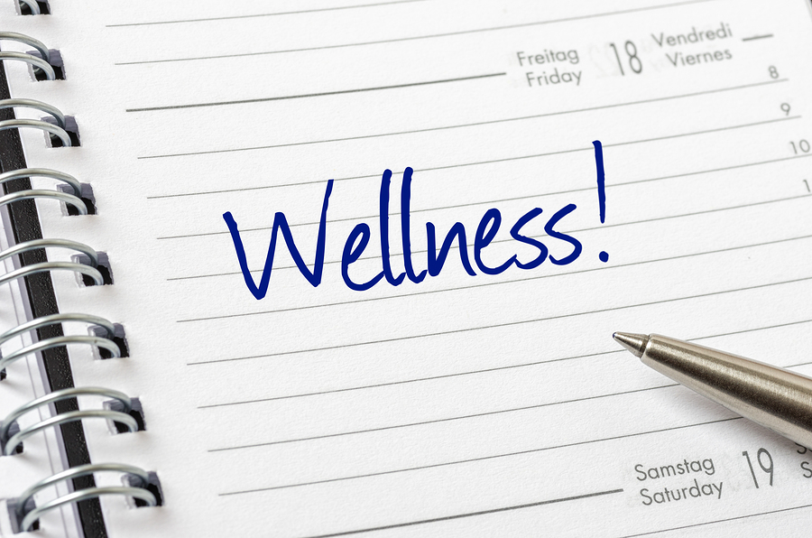 Wellness written on a white calendar page