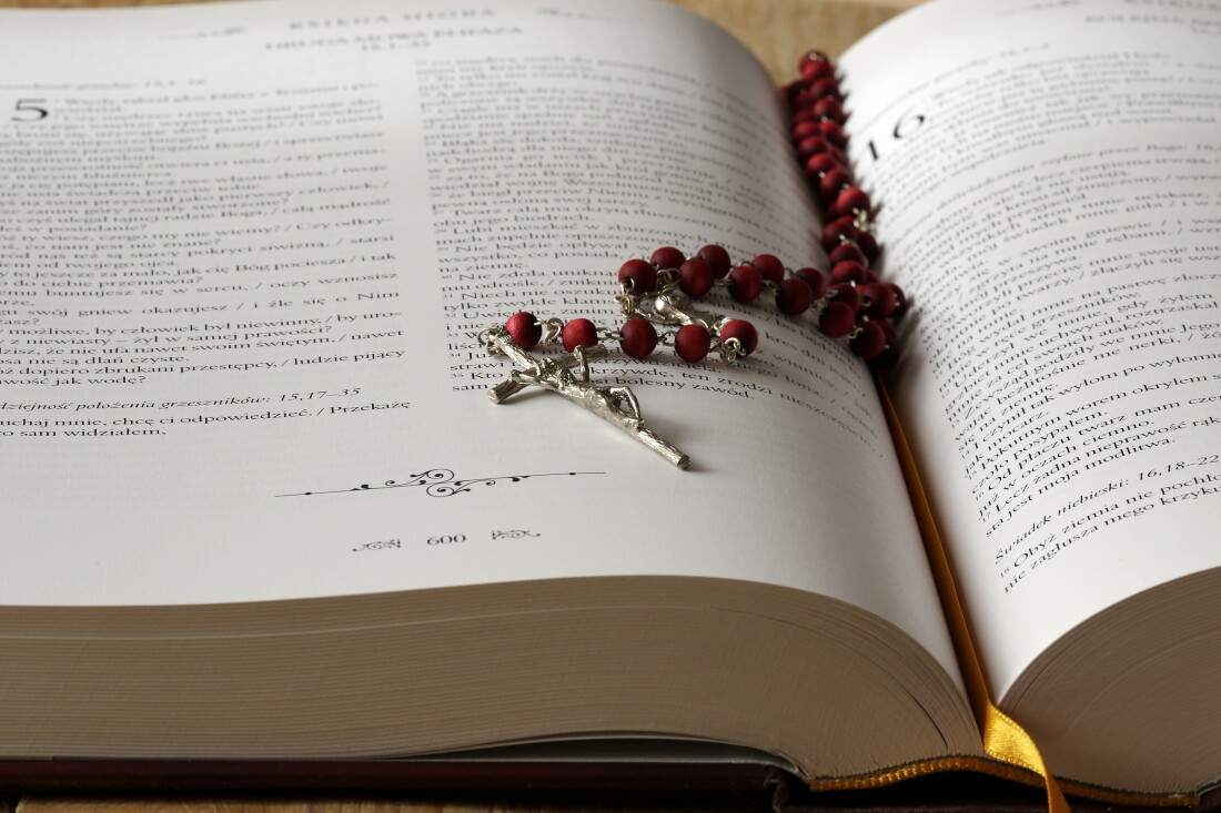 Bible with a rosary